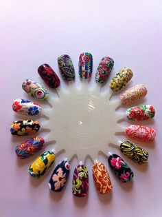 Some nail designs inspired by Floral Prints from the Spring/Summer 2011 catwalk! Floral prints are gonna be HUGE this season! My favourite is the Giles hibiscus flower and eyeball print, so COOL!!!