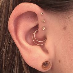 Daith by Jef Saunders. Triple forward helix by Courtney Marriott at Abyss Body Piercing