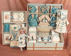 "French Bisque Bebe,Size 0,in Superb Presentation Box with Elaborate Trousseau  10"" (25 cm.) doll. 16"" x 12"" trunk."