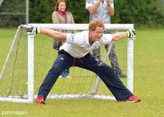 Prince Harry takes part in a game of touch rugby during a visit to a coaching session near Ipswich in Suffolk 29 May 2014