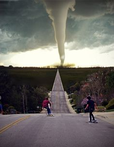 "tornado...these must be southern boys, out playing while thinking ""eh, it's not close enough yet to go inside"""