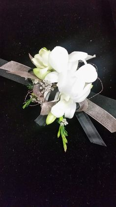White dendrobium orchids with black and rose gold accents