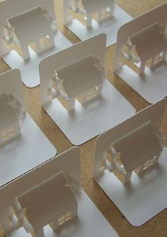 City - Pop up card houses.  Would make a charming housewarming card.  Or a realtor's business card?