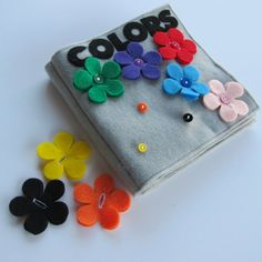 quiet book - buttons sewn onto book and flowers they have to put over buttons - fine motor skills (buttoning) and color matching skills