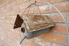 Birdhouse out of old metal cans and tin