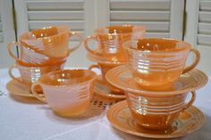 Vintage Fire King Peach Lustre Teacup and Saucers by PanchosPorch Love the gold, have some of my Grandma B. 6172015