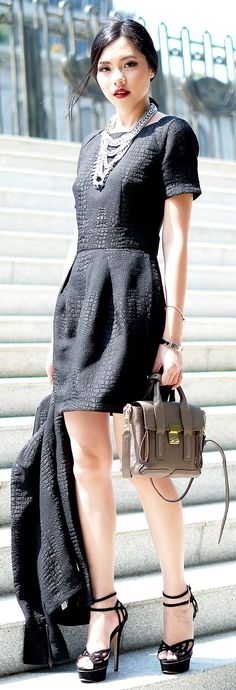 Black Croc, Textured Suit. This woman is sharp, feminine ready for business - love it.