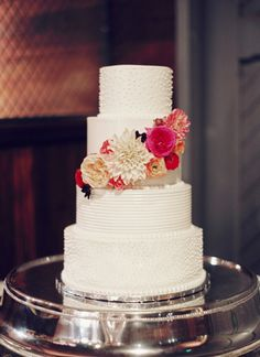 Simple white cake with floral detail.
