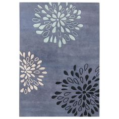 Fresh and playful, this lovely rectangular wool area rug is designed with a floral-inspired pattern that adds an airy feeling to any space. Handcrafted from New Zealand wool, the rug has a lush, 0.7-inch pile that is comfortable to walk on.