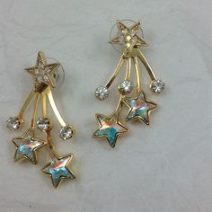 Kirk's Folly shooting star earrings Iridescent stars and crystals In these pierced earrings with detachable shooting star piece so they can be worn as single star earrings. In excellent like new condition, but do not come in original box. Kirk's Folly Jewelry Earrings