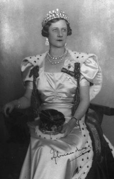 Princess Alexandra, Duchess of Fife in her coronation robes, 1937. Here can be seen the unfortunate effect of rehanging the train from the top of the shoulder. As originally designed the train was hung from the back of the shoulder and the cords & tassels hung from a more logical position.