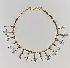 6th century, Early Byzantine necklace with pendant crosses made from pearl sapphire, gold, and smokey quartz.