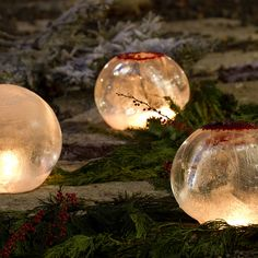 "Ice Lantern.  Fill water balloons and freeze with a ""base"" creating a pocket in the ice.  (Ice Lantern Kit in Holiday Trim Your Home Decorations at Terrain)"
