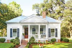 """Exterior Charm - Our New Favorite 800-Square-Foot Cottage That You Can Have Too - Southernliving. To manage the home's tiny footprint, Ingram was meticulous with scale. """"When designing little homes, you run the risk of them looking like playhouses unless you take the proportions really seriously,"""" he says. So he played to a grander scale wherever he could, including the size of the windows and the front-and-center positioning of the porch. From there, it was a matter of adding classic…"""