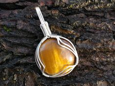 Circular tiger eye and sterling silver wire by OreganickJewelry