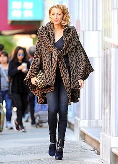Rocking the faux short crop on the set of the new (unnamed) Woody Allen film, Blake looked every inch the '40s era beauty — at least from the neck up. From the shoulders down, Lively stunned in a modern-looking street style outfit, showing off her long legs in skinny J Brand jeans, a sweater by One Great Day, and a luxe leopard cloak by Lindsey Thornburg.
