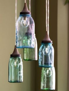 Upcycled Lamps and Lighting Ideas: Aqua and green jars are fitted with funnel tops and Edison bulbs then hung in a cluster to make a vintage-style kitchen light. Design by Brian Patrick Flynn From DIYnetwork.com