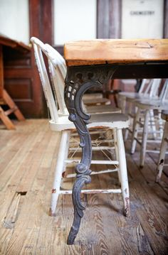 Wrought iron art, detailed wrought iron table legs, rustic table