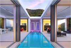 Zephyros Villa  ~ This stunning house is located in Cyprus and was designed by Koutsoftides Architects. The concept was to unify the two buildings and landscapes and get a sense of calm and serenity. The main floor is divided in two by the ion in the middle of a courtyard and pool. The design of the house is facing north to overlook the fishing port of Pomos. Beautiful.