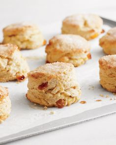 These scones are crisp and golden with a light, flaky interior. The fruit offers a slightly chewy contrast. Orange zest and Grand Marnier flavor the scones. Serve them with butter and tea.