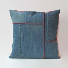 Product Description:  Upcycled denim patchwork pillow with red topstitching. Pillow back is red home dec weight fabric with an envelope closure.