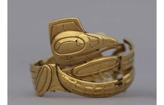 Raven bracelet, c. 1955, gold metal. Dr. Sydney and Dr. Constance Livingstone Friedman Collection,UBC Museum of Anthropology 2923/1