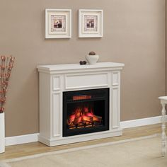 Home Decorators Collection Granville 43 in. Convertible Media Console Electric Fireplace in Antique White with Faux Stone Surround 82636 at The Home Depot - Mobile Electric Fireplace With Mantel, Fireplace Tv Stand, White Fireplace, Faux Fireplace, Fireplace Mantels, Electric Fireplaces, Modern Fireplace, Fireplace Design, Home Depot
