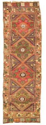KONYA LONG RUG  CENTRAL ANATOLIA, LATE 18TH CENTURY   13ft.6in. x 4ft.2in. (410cm. x 127cm.)  I Christie's Sale 7219
