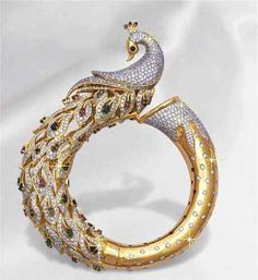 Best Diamond Bracelets : Peacock with diamonds. I believe this is a bangle, considering the joint located at the far end of the tail feathers. Diamond Bracelets, Gold Bangles, Diamond Jewelry, Gold Jewelry, Metal Jewelry, Gold Ring, Diamond Rings, Peacock Ring, Peacock Jewelry