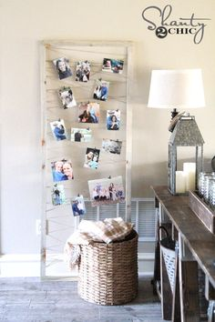 Build a frame and string yarn across it to hang photos from.