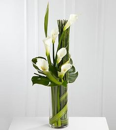The FTD® Eternal Friendship™ Arrangement is an outstanding way to express your deepest sympathies for their loss. Sophisticated white calla lilies are skillfully arranged amongst a collection of exqui Contemporary Flower Arrangements, White Flower Arrangements, Vase Arrangements, Centerpieces, Centerpiece Wedding, Wedding Arrangements, Wedding Decor, Amazing Flowers, Fresh Flowers