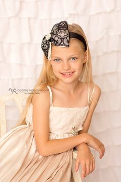 Oversized ivory and blck bow with rhinestone and pearls on a wide satin aliceband