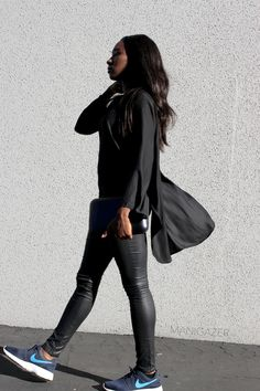 Minimal style   Black coated jeans + asymmetrical shirt + Nike Roshe Run sneakers + metallic clutch in an edgy, casual chic outfit. By Parisian and West African blogger / model Iman from Manigazer.