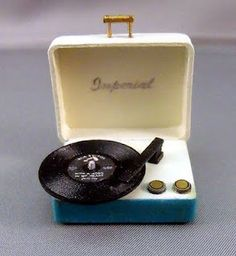 If we do Beatles albums for our table names, I'd love these to be the place cards.  Album name on the record, person's name on the lid!  :)