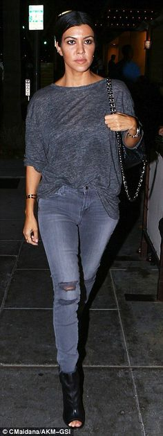 Casual chic: The star paired her trousers with a loose charcoal blouse and black open-toe heels