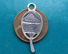 What a beautiful Japanese Fan charm. Very nice detail of both Mt. Fuji Volcano…