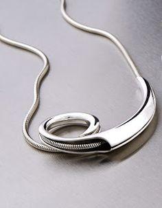 FAUNI series, anticlastic pendant, silver Juha Koskela  www.juhakoskela.com
