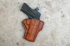 Ever wished you had a great holster for your 1911? Having a great holster isnt just a luxury, its a necessity. Whether at the range, at home or out Best Handguns, Phone Holster, Leather Holster, Vegetable Tanned Leather, Concealment Holsters, Tan Leather, Revolver, Trending Outfits, Brown