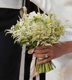 Meghan Markle's bespoke bridal bouquet was designed by florist Philippa Craddock, and contained several flowers that Prince Harry handpicked from their private garden at Kensington Palace the day before the wedding. The bouquet included white Forget-Me-Nots, which were Princess Diana's favourite, so that they could honour her memory on their special day. It also included scented sweet peas, lily of the valley, astilbe, jasmine and astrantia, and sprigs of myrtle, bound together with ribbon. Bouquet Astilbe, Peach Bouquet, Ribbon Bouquet, Flower Bouquet Wedding, Floral Wedding, Wedding Day, Hand Bouquet, Flower Bouquets, Elizabeth Ii