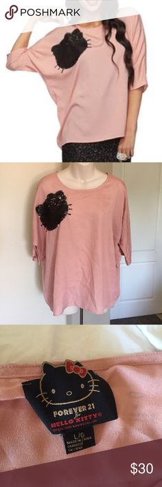 "Forever 21 limited edition Hello Kitty chiffon L This is a Forever 21 chiffon top. It is the limited edition Hello Kitty sequins top. Side large. Dusty pink with black sequins. It is meant to be oversized and drapey. Length 26"". Forever 21 Tops Tees - Short Sleeve"