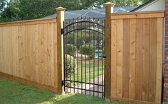 wood fence with metal gate | Ruiz Fencing