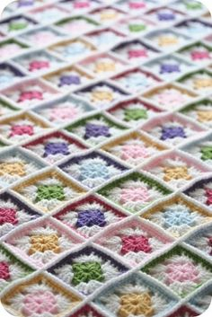 A warm crocheted blanket AND a treat for the eyes! Looks like a rainbow- perfect for a little girl's room.
