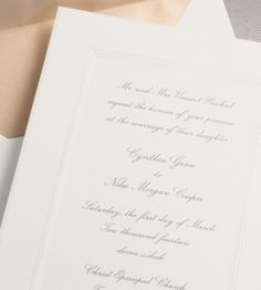 Our Pearl Border invitation is shown here thermograph printed in charcoal ink.
