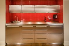 Rec room kitchenette in stainless steel and red glass tile. Discovered on search.porch.com #interiors #interiordesign #decor #tile #red #kitchenette