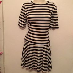 BNWT TRINA TRINA TURK DROP WAIST STRIPED DRESS L this is an absolutely beautiful casual dress by TRINA TRINA TURK.  Size LARGE.  90% viscose and 10% elastane.  Long top with short sleeves and short skirt.  Black and white stripes go horizontally on the top and vertically on the skirt.  Pull over the head style.  NO LINING.  Would look great with leggings and boots.  Very versatile.  BRAND NEW WITH TAGS AND IN PERFECT CONDITION!!  I paid $168 + shipping.PLEASE CHECK OUT THE REST OF MY TOP…