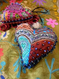 This beaded heart is definitely on my list of heart sewing projects. Striking heart Pin Cushions