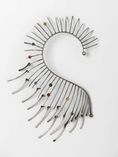 Necklace | Art Smith.   Metallic Boa,  c 1964.  Spikes emanating from the curbed spine are decorated with 8 bezel-set hard stones.