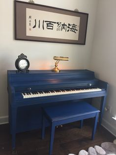 Chalk painted piano in navy blue, distressed and coated in brown wax