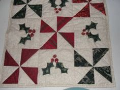 Pinwheels and Holly Table Topper http://www.favequilts.com/Christmas-Projects/Pinwheels-and-Holly-Table-Topper