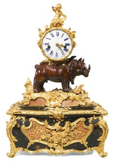 A Louis XV gilt-bronze, bronze and Vernis Martin musical rhinoceros table clock, circa 1748, attributed to Jean-Joseph de Saint-Germain | Lot | Sotheby's